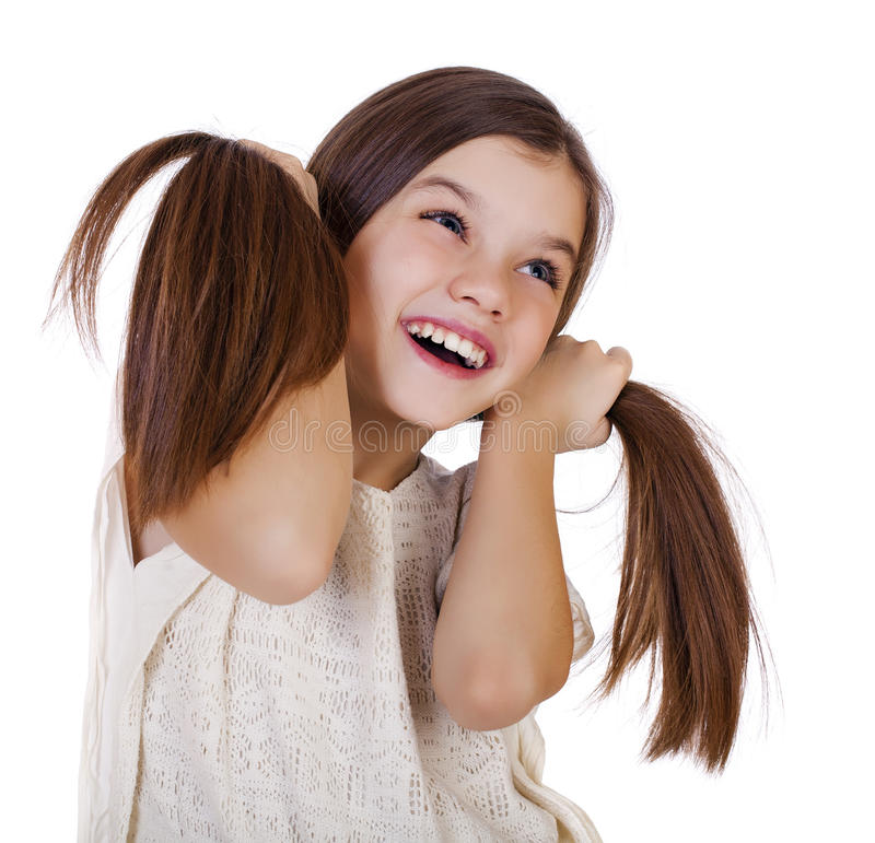 Portrait of a charming little girl smiling at camera stock images