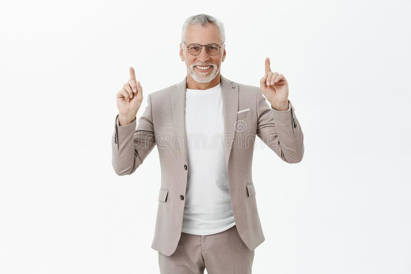 Portrait of charming successful and happy stylish old man with white beard and hairstyle in glasses and elegant suit royalty free stock images