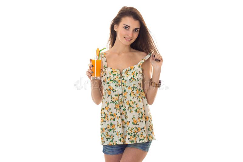 Portrait of charming young brunette woman in sarafan with floral pattern posing isolated on white background stock photo