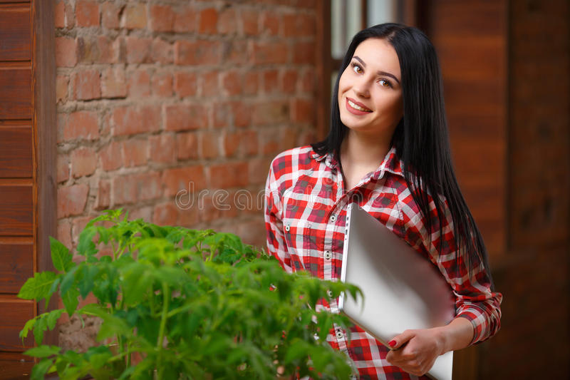 Portrait of a charming young female gardening royalty free stock photo