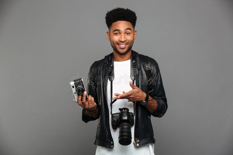 Portrait of a cheerful afro american guy in leather jacket stock images