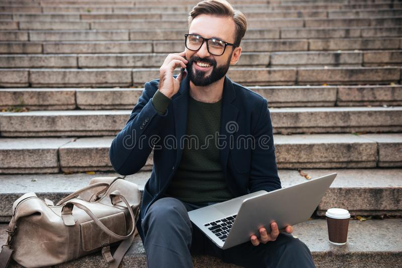 Portrait of a cheerful attractive man in eyeglasses stock photos