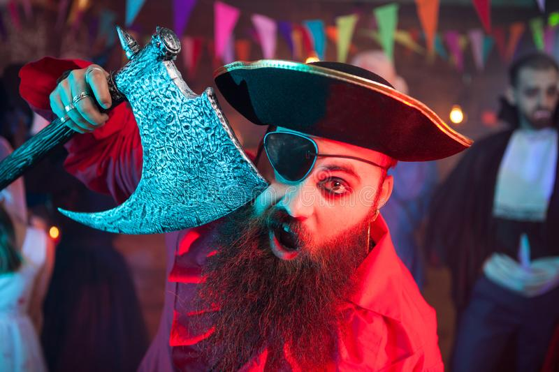 Portrait of cheerful bearded men dressed up like a pirate at a halloween party stock photography