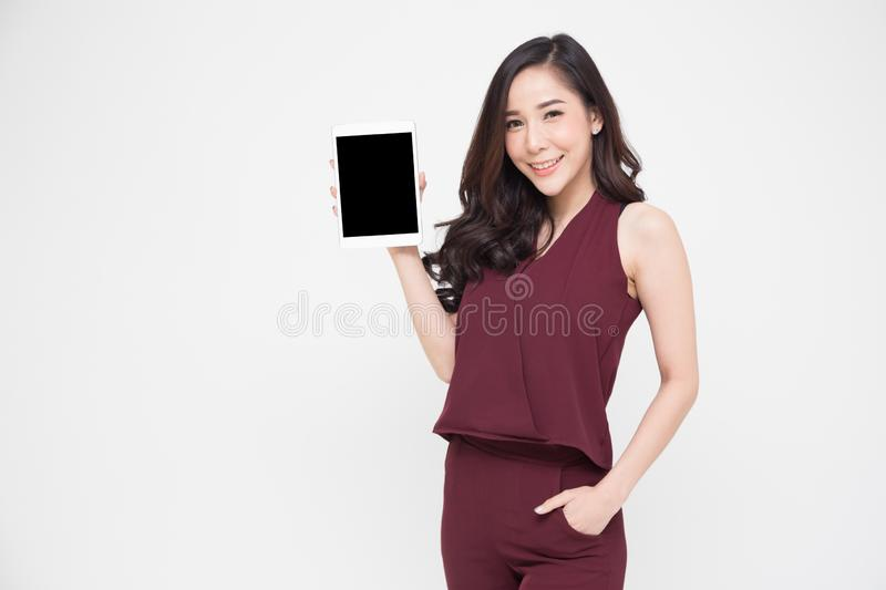 Portrait of a cheerful beautiful girl  and showing or presenting tablet application isolated over white stock photos