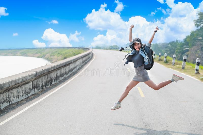 Portrait of cheerful and beautiful woman jumping while traveling on holiday vacation royalty free stock photo