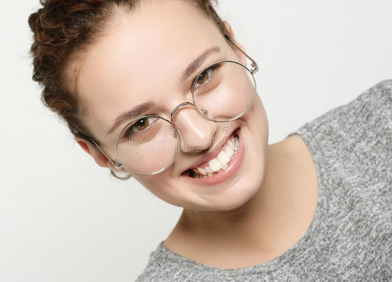 Portrait of cheerful beautiful woman eyewear with pleased look, stock photography