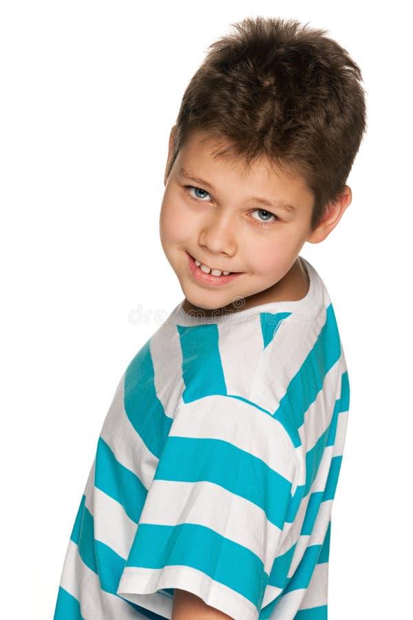 Cheerful boy looks back stock photos