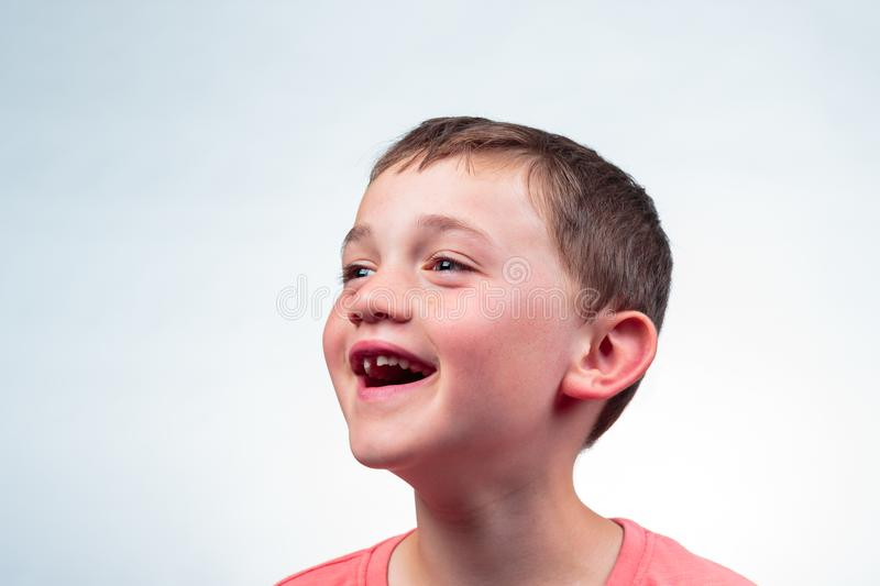 Portrait of cheerful boy missing a milk tooth royalty free stock images
