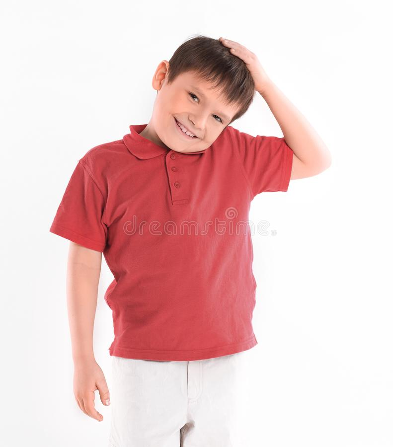 Portrait of a cheerful boy in a red t-shirt.isolated on white background stock image