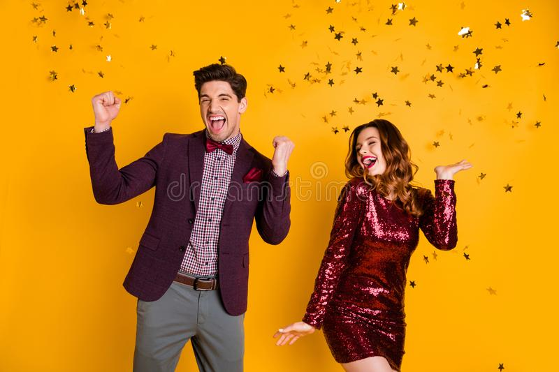 Portrait of cheerful buddies fooling close yes feel content scream shout raise fists isolated over yellow background. Portrait of cheerful buddies, fooling close royalty free stock photos
