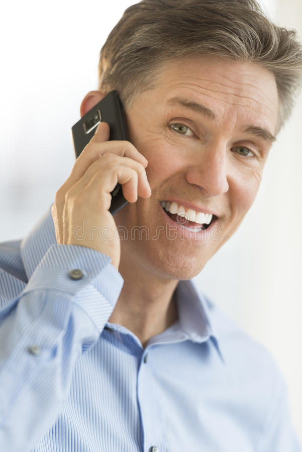 Download Portrait Of Cheerful Businessman Using Smart Phone Stock Photo - Image: 32062400