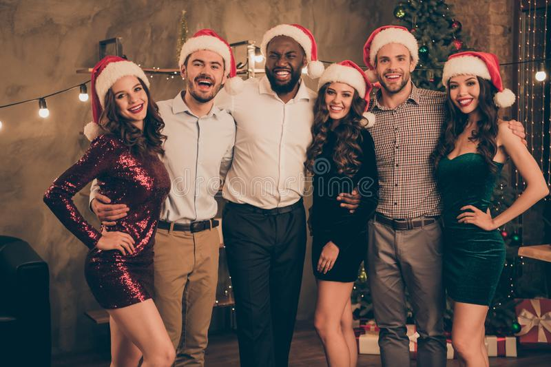 Portrait of cheerful charming group of fellows hug celebrate christmas night at x-mas party in house with noel. Portrait of cheerful charming group of fellows royalty free stock image