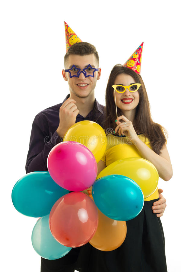 Portrait of cheerful couples at a party the day of birth. Vertical portrait of cheerful couples at a party the day of birth royalty free stock images