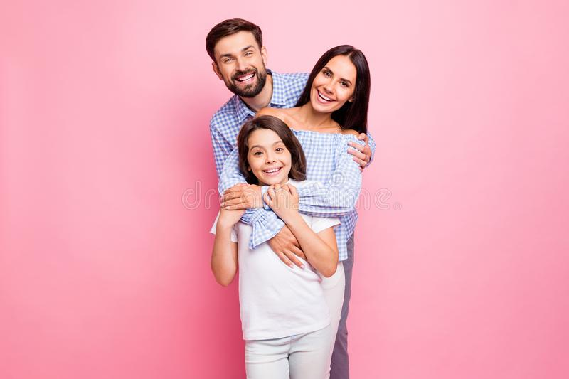 Portrait of cheerful family cuddling smiling wearing checkered plaid shirt off-shoulders white t-shirt isolated over stock photography