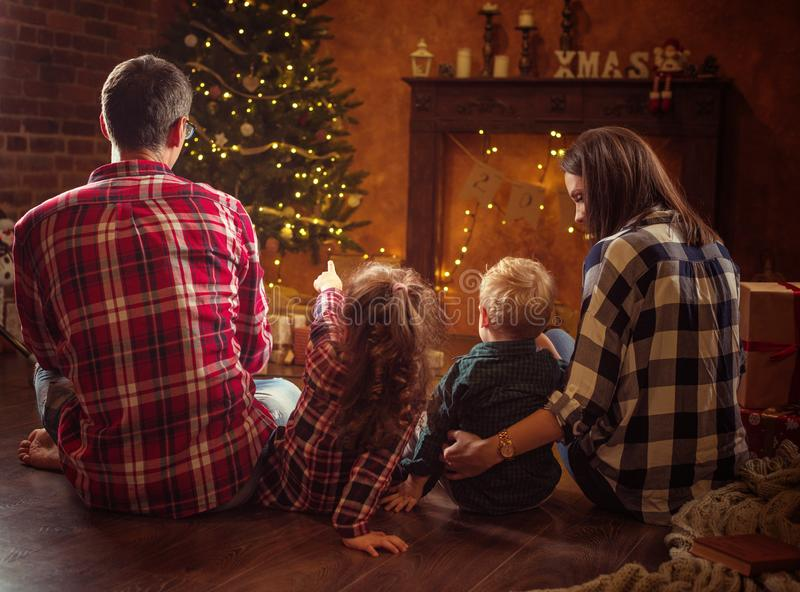 Portrait of a cheerful family realxing in a winter evening stock photography