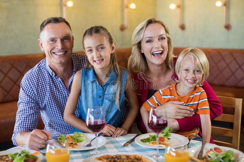 Portrait of cheerful family at restaurant stock images