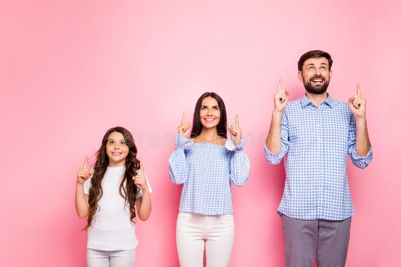 Portrait of cheerful family with wavy long haircut look up wear white t-shirt trousers checkered plaid shirt off stock photography
