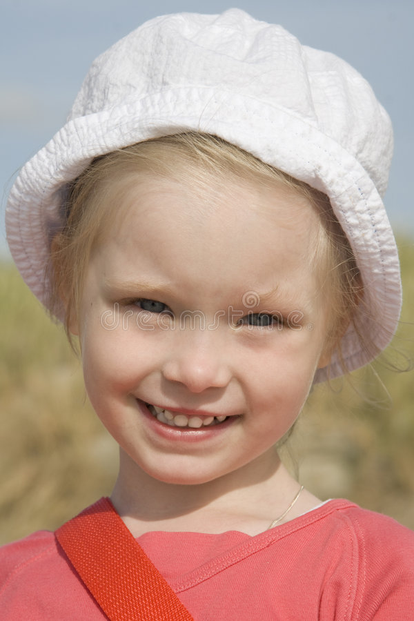 Portrait of cheerful girl on the beach stock image