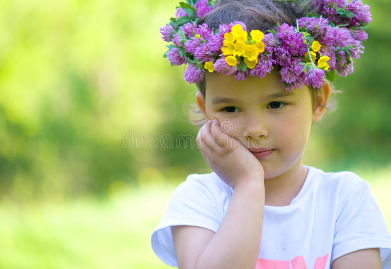 cheerful girl with a wreath of flowers on her head royalty free stock images