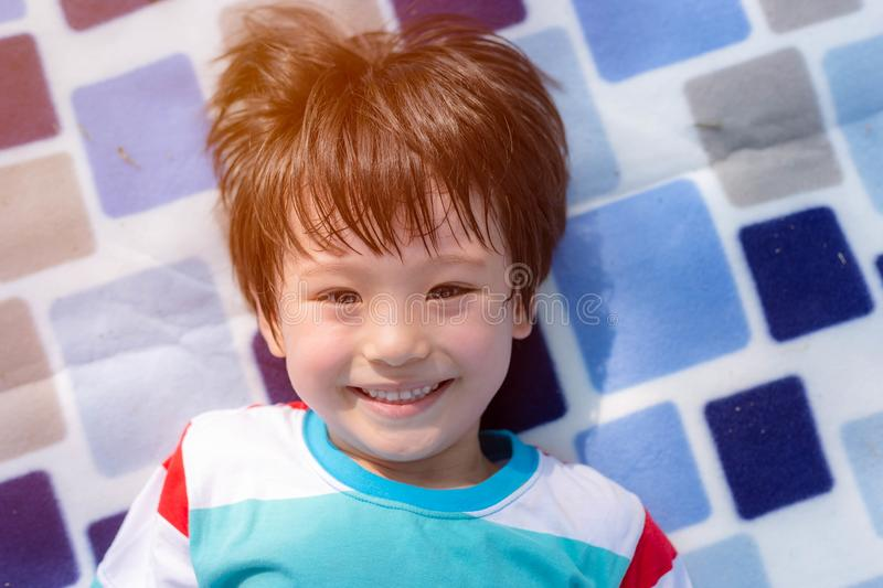 Portrait cheerful handsome little boy. Attractive handsome mix race kid gets enjoying life and gets happiness. Cute child look stock photos