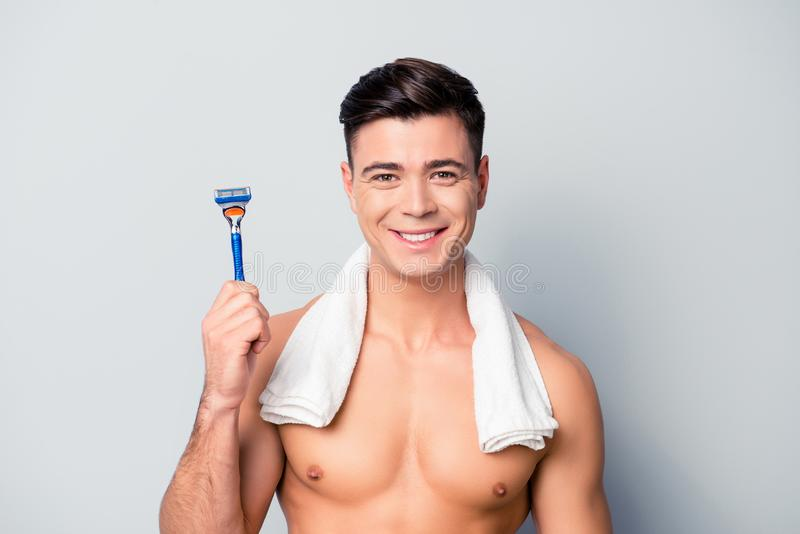 Portrait of cheerful handsome sporty smiling shaven guy wit stock images