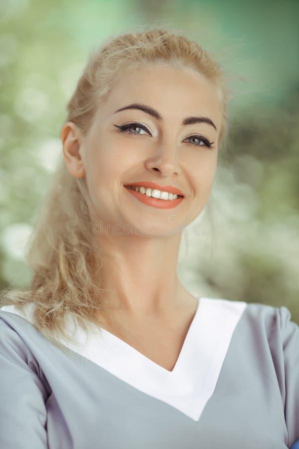 Portrait of cheerful happy doctor in gray uniform stock photo