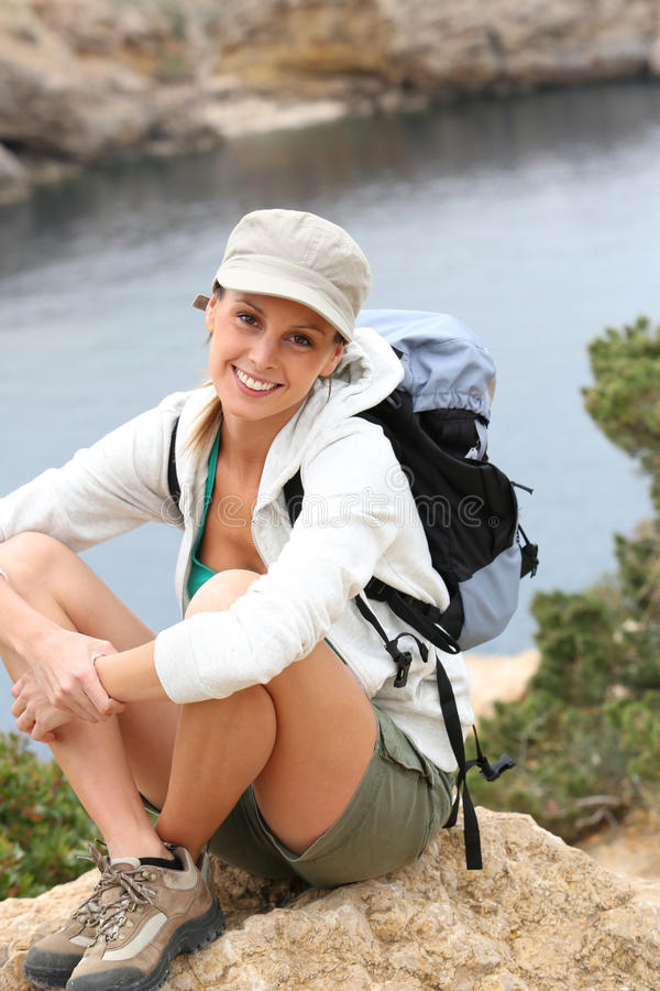 Portrait of cheerful hiking woman relaxing royalty free stock photo