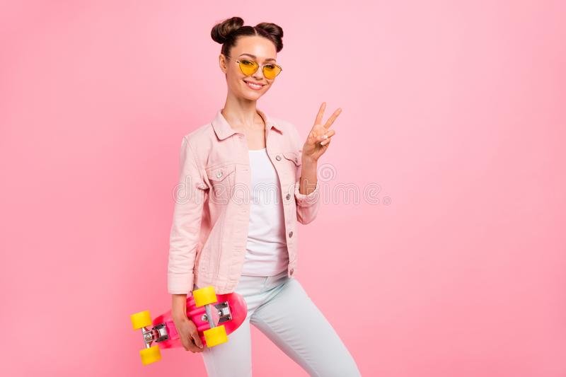 Portrait of cheerful lady making v-signs wearing jacket isolated over pink background. Portrait of cheerful lady making v-signs wearing jacket isolated over royalty free stock image