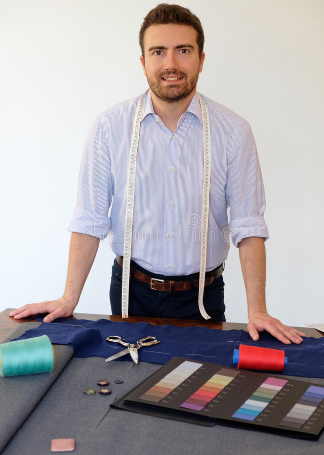 Portrait of cheerful male tailor royalty free stock photos