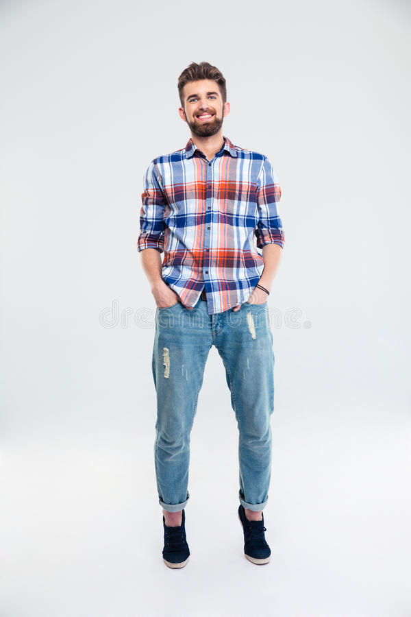 Portrait of a cheerful man in casual cloth. Standing isolated on a white background. Looking at camera royalty free stock images