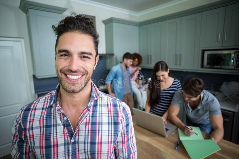 Portrait of cheerful man with friends in background stock photos