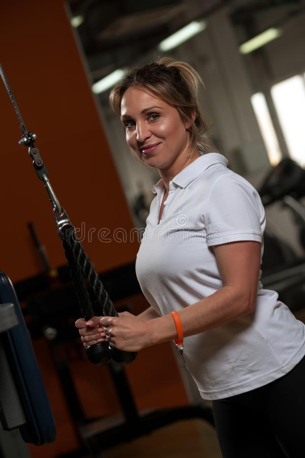 Cheerful middle aged woman working out in gym royalty free stock photo