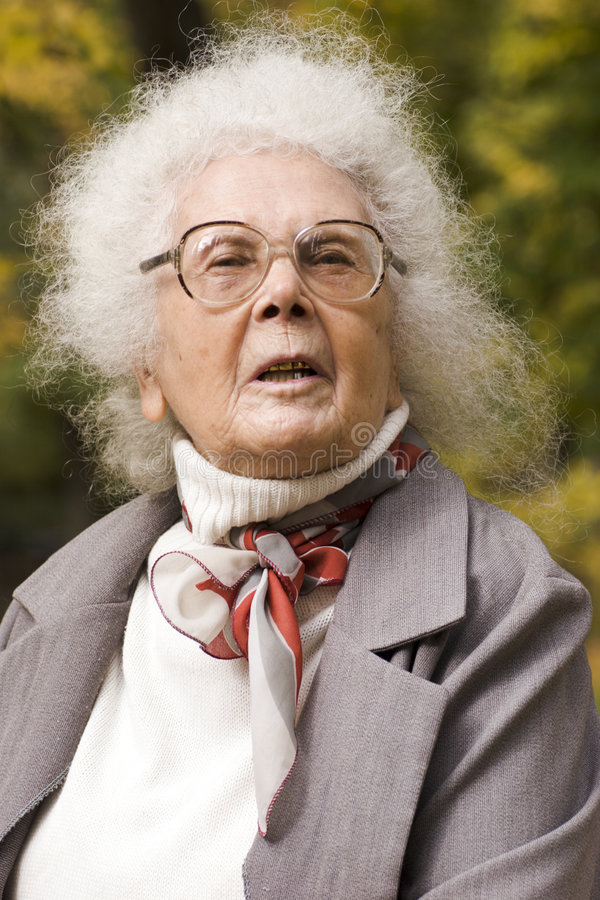 Portrait of cheerful old lady royalty free stock image
