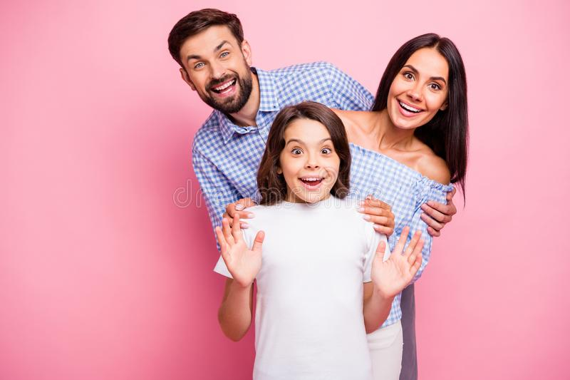 Portrait of cheerful people screaming wow omg wearing checkered top white t-shirt isolated over pink background royalty free stock image