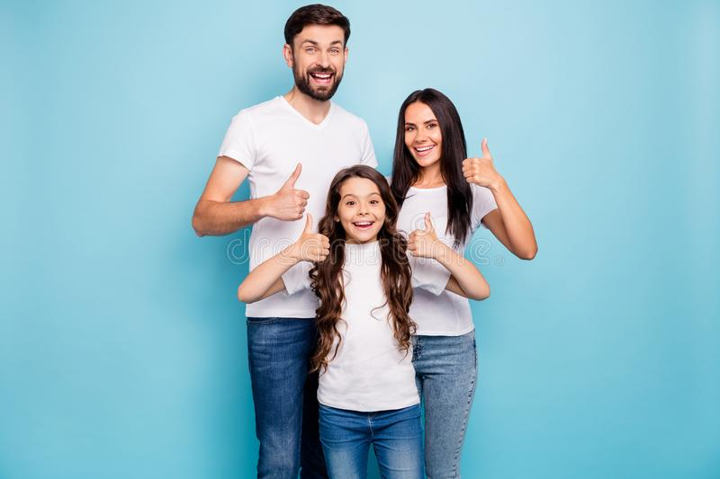Portrait of cheerful positive three brunet hair people promoters show thumb up recommend sales wear white t-shirt denim stock images
