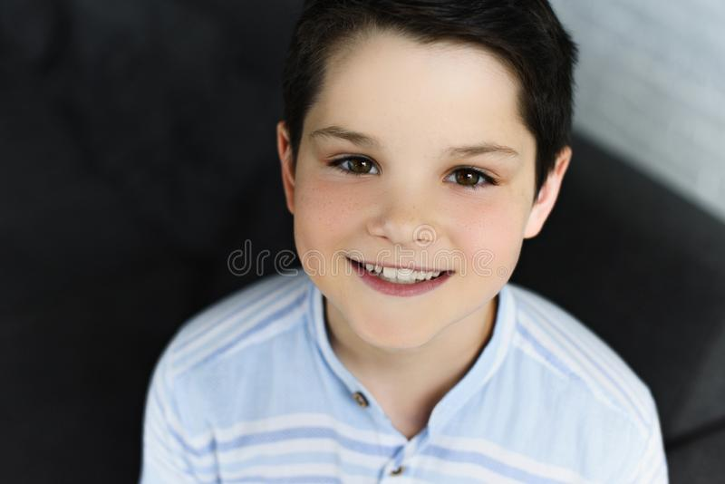 portrait of cheerful preteen boy looking at camera stock photography