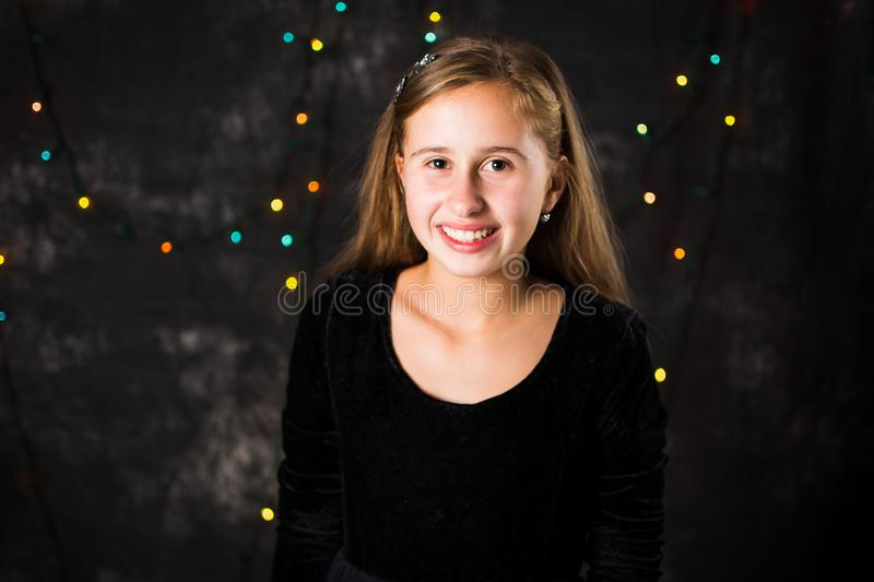 Portrait of cheerful teenage girl on festive background royalty free stock images