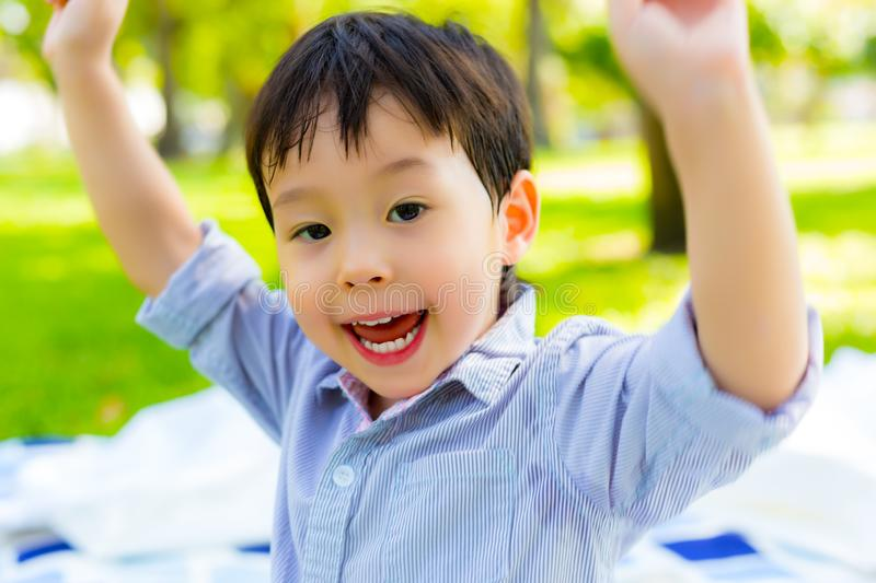Portrait cheerful toddler or preschool boy. Lovely little boy feel happy and yelling that kid gets long weekend holiday. Cute royalty free stock photo