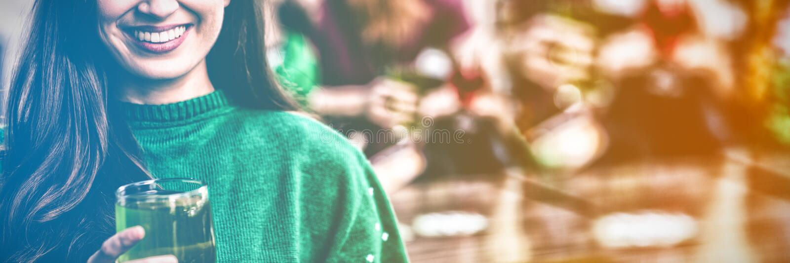 Portrait of cheerful woman celebrating St Patricks day stock images