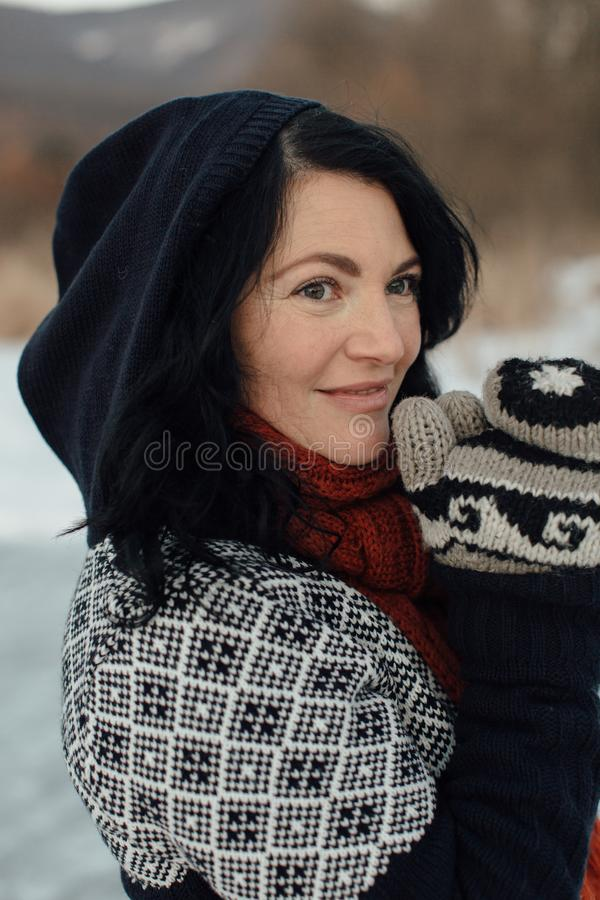 Smiling woman feeling cold outside on a frozen lake royalty free stock photography