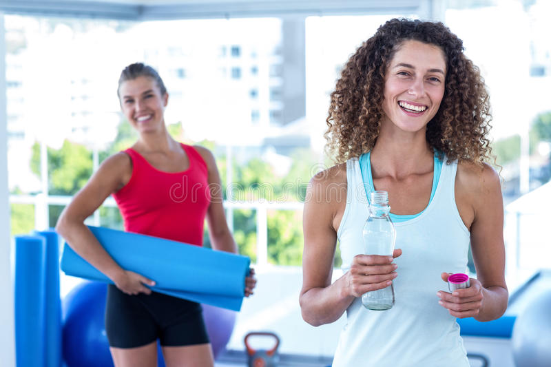 Portrait of cheerful women in fitness studio royalty free stock image