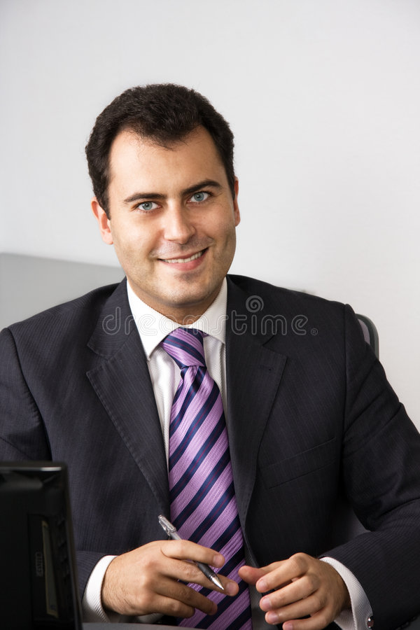 Portrait of a cheerful young businessman stock photo
