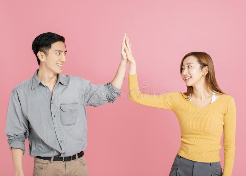Portrait of  cheerful young couple standing together stock photography