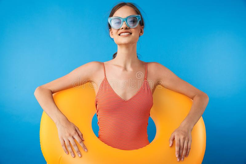 Portrait of a cheerful young girl in swimsuit royalty free stock image