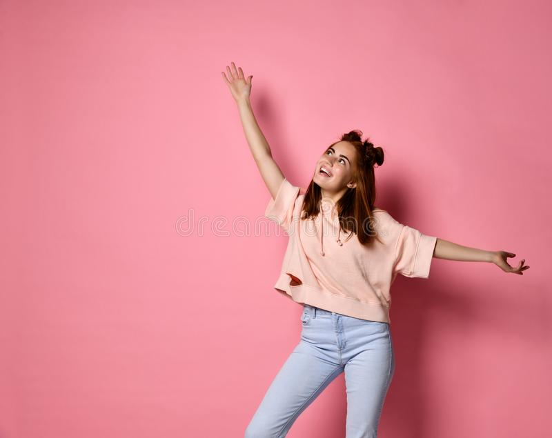 Portrait of a cheerful woman waving her hands on top royalty free stock images