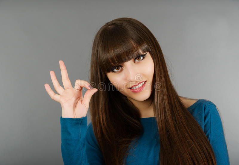 Download Portrait Of Cheerful Young Woman Gesturing Okay Stock Image - Image: 30372501