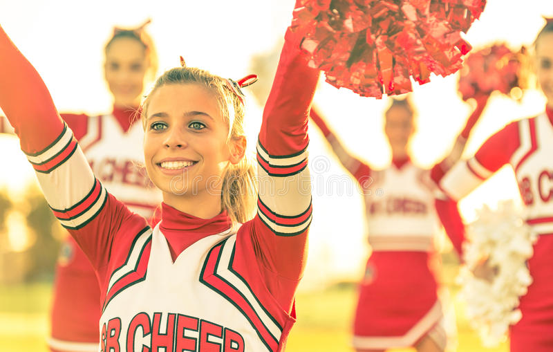 Portrait of a cheerleeder in action. Bright emotional portrait of a cheerleeder in action royalty free stock images