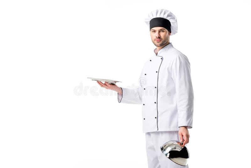Portrait of chef with empty serving tray. Isolated on white royalty free stock image