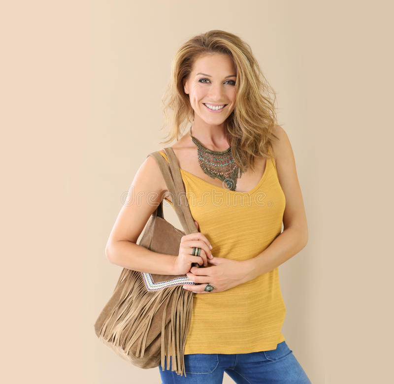 Portrait of chic elegant woman with leather bag royalty free stock photos