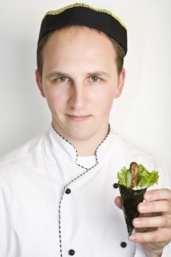 Portrait chief cook with to prepare susi stock image